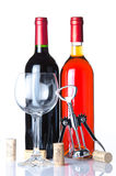 Bottle of wine with a glass and a corkscrew Royalty Free Stock Photography