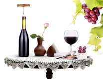 Bottle, wine glass with flower and food on a table Stock Photos