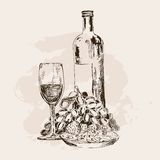 Bottle of wine, glass, grapes and snacks Stock Photos