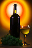 Bottle of wine with glass and grapes Royalty Free Stock Image