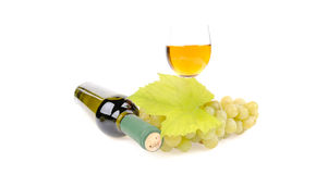 Bottle of wine with glass and green grapes Stock Photos