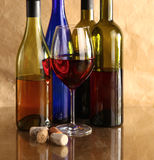 Bottle of wine on a glass table Stock Photo