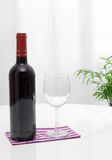 Bottle of wine and glass on the table royalty free stock photo