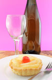 Bottle of wine, glass and tart Stock Photos