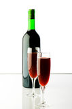 Bottle and wine glasses Stock Images