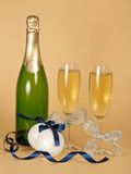 Bottle and wine glasses with champagne Stock Images