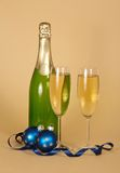Bottle, wine glasses with champagne and Christmas Royalty Free Stock Photos