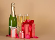 Bottle and wine glasses with champagne, three gift Royalty Free Stock Image