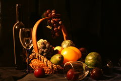 Bottle of wine, glasses and fruit. Classical composition: bottle of wine, glasses and basket of grapes and vegetables Royalty Free Stock Photo