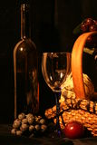 Bottle of wine, glasses and fruit Royalty Free Stock Images