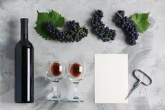 Bottle of wine glasses grape corkscrew empty card mockup. Bottle of wine two glasses grape with leaves, corkscrew, white empty card mockup for your logotype or stock photo