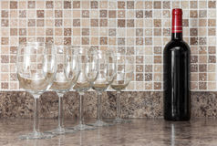 Bottle of wine and glasses on kitchen countertop Royalty Free Stock Image