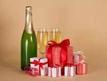 Bottle and wine glasses with small gift boxes Stock Images
