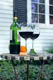 Bottle of Wine and glasses on a table Stock Photos