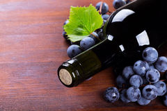 Bottle of wine with grape Stock Photos