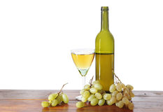 Bottle of wine and grape bunches Stock Images