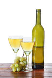 Bottle of wine and grape bunches Royalty Free Stock Photo
