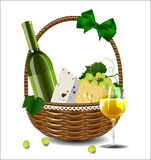 A bottle of wine, grapes and cheese in a wicker basket. Royalty Free Stock Photos