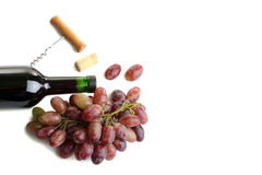 Bottle of wine  with  grapes. Bottle of wine and a corkscrew with  grapes on white isolated background Stock Photos