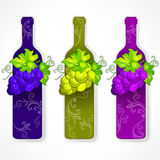 Bottle wine with grapes and pattern Stock Image