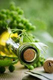 Bottle of wine and green leaves Stock Photo