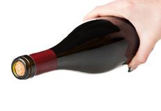 Bottle of wine in hand Royalty Free Stock Images