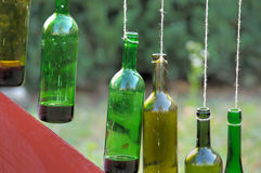 Bottle of wine. Hanging on a cord Royalty Free Stock Photography