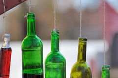 Bottle of wine hanging on a cord. Colored bottle of wine hanged as bells stock photography