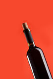 A bottle of wine isolated on red Royalty Free Stock Photos