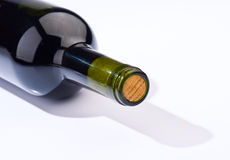 Bottle of wine and its shadow Royalty Free Stock Photo