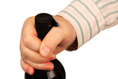 Bottle of wine in a man's hand Royalty Free Stock Photo