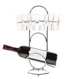 Bottle of wine on a metal stand with glasses. On the white background royalty free stock images