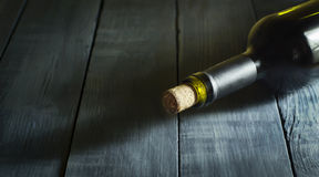Bottle of wine in the old blue wooden background. Royalty Free Stock Photo