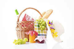 Bottle of wine and picnic  food in a basket Stock Photos