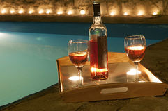 Bottle of wine at poolside. 2 glasses and bottle of wine at poolside, romance Stock Photo