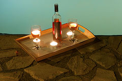 Bottle of wine at poolside. 2 glasses and bottle of wine at poolside, romance Royalty Free Stock Images