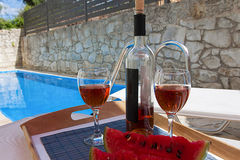 Bottle of wine at poolside Stock Photos