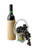 Bottle of wine and ripe grapes isolated on white Stock Photos