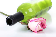 Bottle of wine and roses Stock Photos