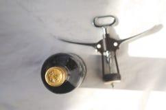 Bottle of wine sommelier corkscrew. A bottle of wine sommelier corkscrew stock photo