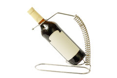 Bottle of wine on the stand. Bottle of wine on a stand made of stainless steel royalty free stock images