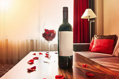 Bottle of wine on a table at sunset at home Royalty Free Stock Photo