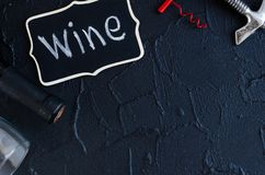 Bottle of wine with two corkscrews royalty free stock photography