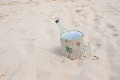 Bottle of wine and two glasses on sandy beach Royalty Free Stock Photography