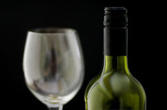 Bottle of wine and a wine glass Royalty Free Stock Photo