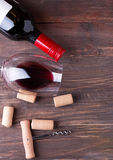 Bottle of wine, wine glass, corks and corkscrew Royalty Free Stock Photos