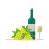 Bottle of Wine and Wineglass. Bottle of white wine and wineglass with bunches of wine grapes. Bottle with label and glass of white wine. Wineglass full of white Stock Photo
