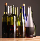 Bottle of wine on a wooden table Stock Photos