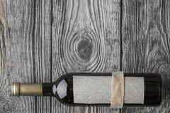 Bottle of wine on the wooden table top view Stock Photography