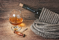 Bottle of wine wrapped with rope Royalty Free Stock Images